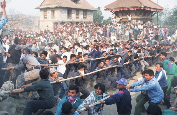 Villagers are whipped into frenzy of excitement as they enjoy a ceremonial tug of war in the streets of Bhaktapur at the climax of the Bisket Jatra festival. The winners are considered blessed with good fortune for the coming year. The festival lasts for seven days and signifies the beginning of the Nepali New Year.