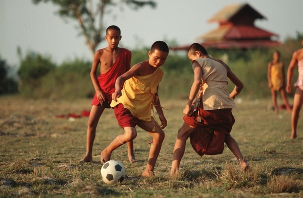 Burmese monks playing football close to Inle Lake.