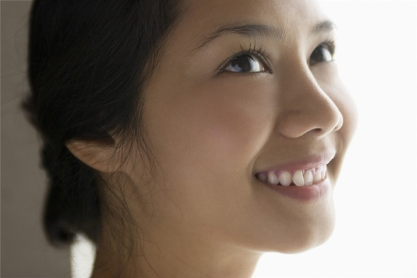 A portrait of a young Asian woman.  MODEL RELEASED