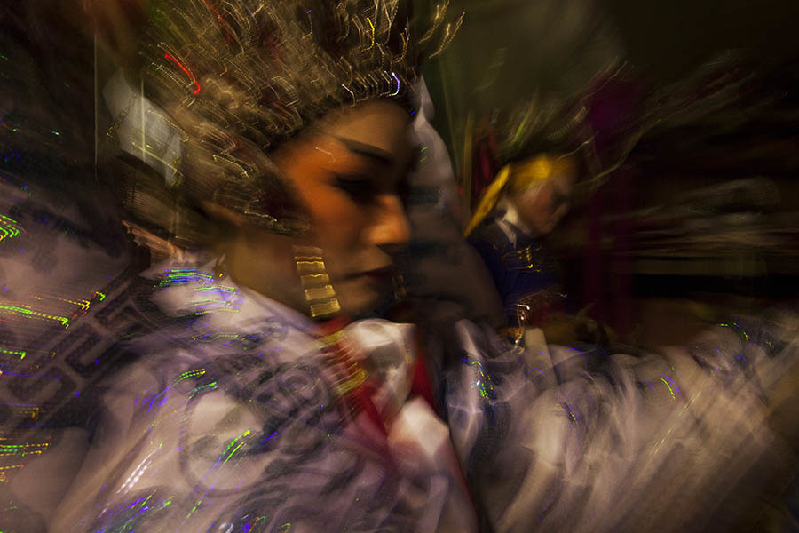 A Chinese opera performer rushes onto the stage during a show in Bangkok. Chinese opera is performed in Thailand by itinerant groups of players, most of whom are from the northeastern region of Thailand known as Isan. It is characterised by its lavish costumes, the falsetto delivery of its actors and the highly stylised presentation of its set-piece stories which are drawn from Chinese folklore. Though the operas are performed in Chinese most of the actors don't understand Chinese and simply learn their parts by rote. Chinese opera is colourful reminder of the importance of Thailand's ethnic Chinese population, and of how Chinese culture has become an integral part of Thailand's cultural identity. Though the Chinese opera is appreciated by an ageing, and dwindling, population of Chinese speakers, the performers explain that audience sizes is of little importance since they essentially performing for the gods. The shows are usually sponsored by the local community, are free for all to attend and usually last between two and three days.