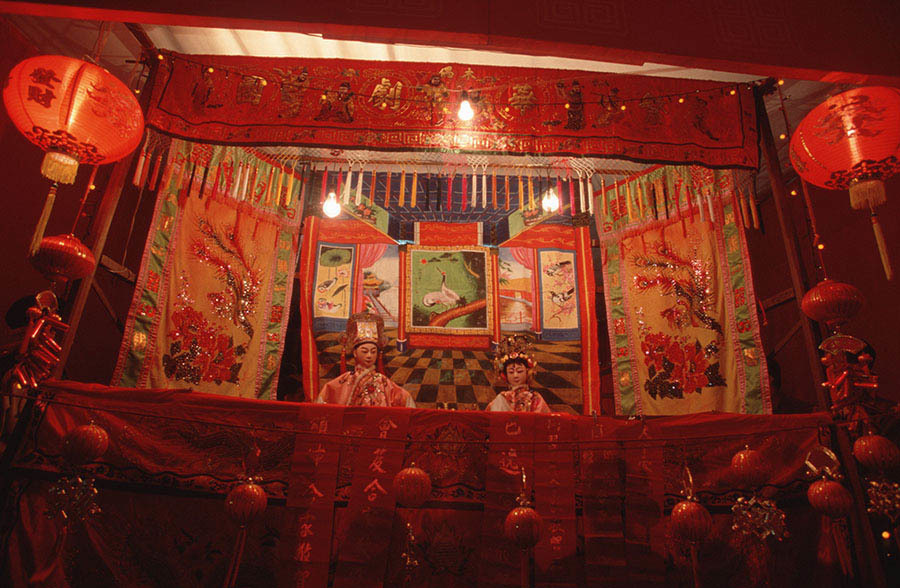 A stage view of a traditional chinese opera (known as Ngiew) during the Chinese new year festivities in the Yaowarat area of Bangkok.   The chinese community constitutes a significant and influential minority in Thailand. Bangkok in particular has a large minority of Chinese and Thai-Chinese. Many Chinese immigrated to Thailand under re-population programs, working as laborers and merchants in the 1950s (particularly after the culture revolution in China), but the community has roots in Thailand going back hundreds of years.  These days the ethnic Chinese minority controls much of the economic power of the country. Most younger generation Chinese have fully assimilated Thai culture, language and traditions. Chinese language, especially taechew, is still spoken among many elders.  During the Chinese New Year Bangkok's chinatown comes alive with dragon dancing, traditional Chinese opera and a wide array of traditional delicacies.