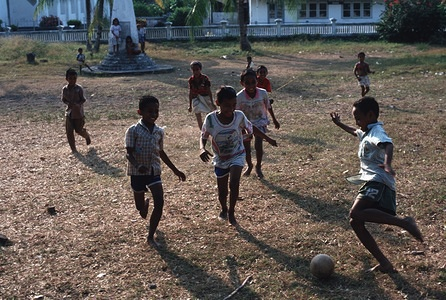 Children play soccer on an open patch of ground on the sleepy island of Banda Naira.