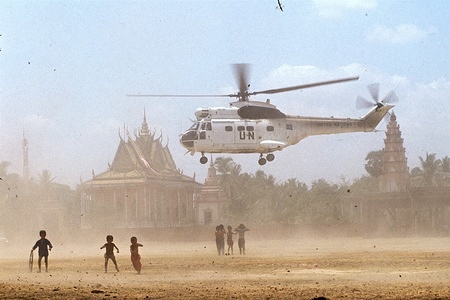 A United Nations helicopter takes off near a temple complex, part of the United Nations operation to restore peace in Cambodia designated UNTAC (the United Nations Transitional Authority in Cambodia).
